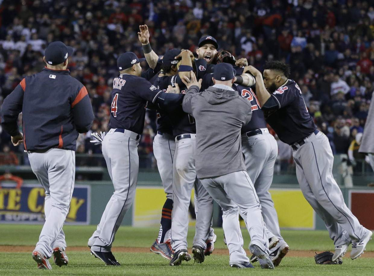 The Cleveland Indians celebrate their 4-3 win over the Boston Red Sox in Game 3 of baseball's American League Division Series, Monday, Oct. 10, 2016, in Boston. (AP Photo/Elise Amendola)
