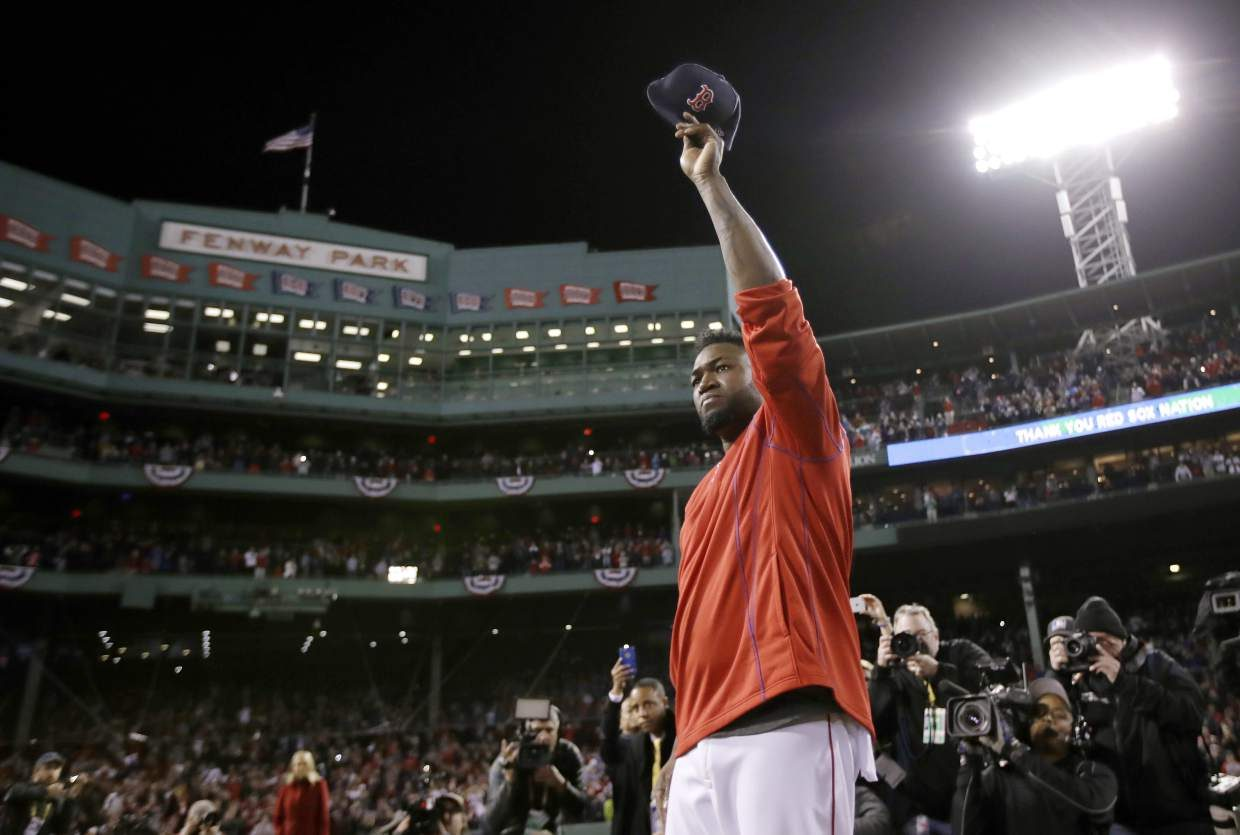 Boston Red Sox's David Ortiz waves from the mound at Fenway Park after Game 3 of baseball's American League Division Series against the Cleveland Indians, Monday, Oct. 10, 2016, in Boston. The Indians won 4-3 to sweep the Red Sox in the series. Ortiz said he will retire at the end of the season. (AP Photo/Charles Krupa)