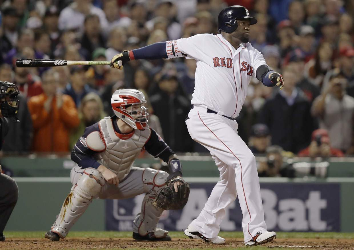 Boston Red Sox designated hitter David Ortiz watches his sacrifice fly, that scored Dustin Pedroia, in front of Cleveland Indians catcher Roberto Perez, left, during the sixth inning in Game 3 of baseball's American League Division Series, Monday, Oct. 10, 2016, in Boston. (AP Photo/Charles Krupa)