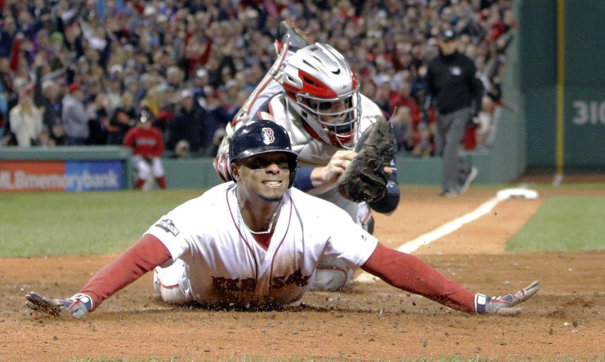 Boston Red Sox's Xander Bogaerts slides safely into home past Cleveland Indians catcher Roberto Perez, right, on a double by Andrew Benintendi during the fifth inning in Game 3 of baseball's American League Division Series, Monday, Oct. 10, 2016, in Boston. (AP Photo/Elise Amendola)
