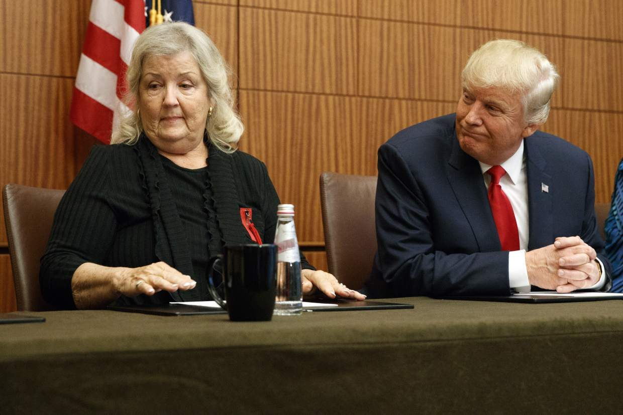 Republican presidential candidate Donald Trump, right, looks on as Juanita Broaddrick, who has accused former President Bill Clinton of sexual assault, speaks before the second presidential debate against democratic presidential candidate Hillary Clinton, Sunday, Oct. 9, 2016, in St. Louis. (AP Photo/ Evan Vucci)