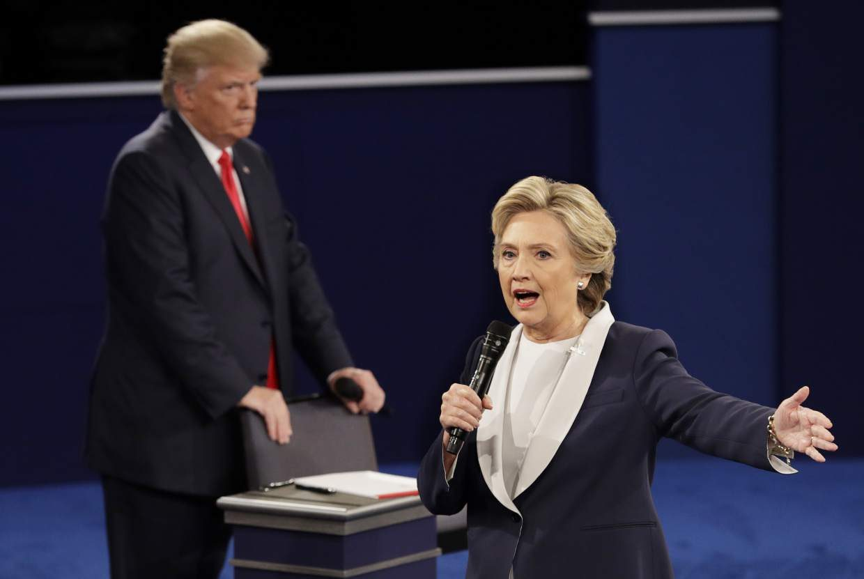 Republican presidential nominee Donald Trump listens to Democratic presidential nominee Hillary Clinton during the second presidential debate at Washington University in St. Louis, Sunday, Oct. 9, 2016. (AP Photo/John Locher)