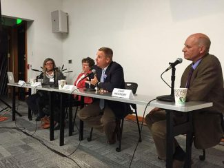 Candidates for 9th Judicial District Attorney participated in a relatively amicable debate sponsored by Aspen Public Radio on Monday night in the new community room of the Pitkin County Library. From left is APR News Director and moderator Carolyn Sackariason, current-DA Sherry Caloia, Jeff Cheney and Chip McCrory.