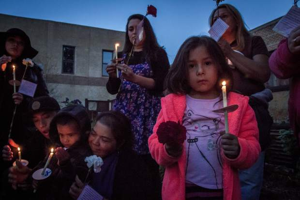 Five-year old Vanessa Gonzalez shows her support during the domestic violence awareness vigil in Centennial Park in Glenwood Springs Thursday evening. The vigil was put together by The Advocate Safehouse Project for National Domestic Violence Awareness Month and was an opportunity to help the community, the survivors of domestic violence and their families heal. For more information about the Advocate Safehouse Project go to advocatesafehouse.org