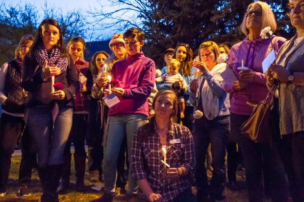 A large crowd dressed in purple (the designated color for National Domestic Violence Awareness) gathers at Centennial Park on Thursday evening to take part in the vigil that was put together by The Advocate Safehouse Project for National Domestic Violence Awareness Month. The was an opportunity to help the community, the survivors of domestic violence and their families heal. For more information about the Advocate Safehouse Project go to advocatesafehouse.org