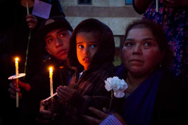 Three-year old Layton Salas (center) and Blanca Judith-Salas(left) show their support at the domestic violence awareness vigil held in Centennial Park in Glenwood Springs on Thursday evening. The vigil was put together by The Advocate Safehouse Project for National Domestic Violence Awareness Month and was an opportunity to help the community, the survivors of domestic violence and their families heal. For more information about the Advocate Safehouse Project go to advocatesafehouse.org