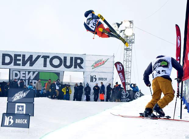Jaxin Hoerter of Breckenridge airs out of the pipe while Canadian Noah Bowman clips in during practice runs before the men's freeski superpipe at Dew Tour in Breckenridge in 2015. The event returns to Breckenridge with a new format Oct. 8-11.