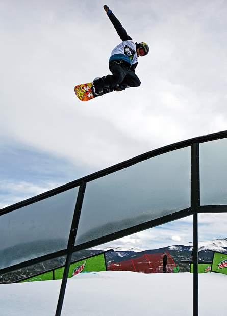 Canada's Tyler Nicholson airs over a rail during the Dew Tour men's snowboard semi-finals at Breckenridge Ski Resort in 2015. The event returns to Breckenridge with a new format Oct. 8-11.