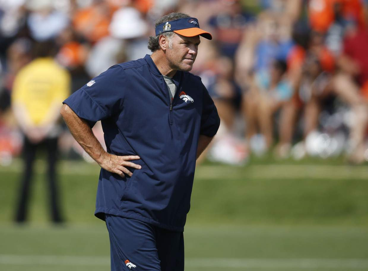 In this Friday, July 29, 2016, photograph, Denver Broncos special teams coach Joe DeCamillis takes part in drills during the team's NFL football training camp in Englewood, Colo. DeCamillis will guide the Broncos when they play against the Chargers in San Diego on Thursday night. Broncos head coach Gary Kubiak will miss this week's game after being diagnosed with a complex migraine condition that caused extreme fatigue and body weakness. (AP Photo/David Zalubowski)