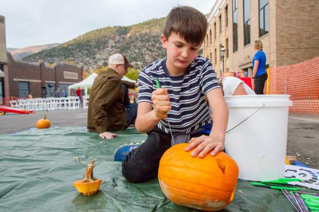 10-year old Maddox Bennett working on his pumpkin during Friday night's Glen-A-Palooza Lumber Jack Bash.