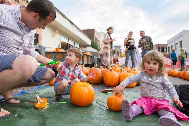 Two-year old Landon Vaught (center) and two and a half year old Carolyn Kimmel spent Friday evening carving pumpkins at the Glen-A-Palooza Lumber Jack Bash on Cooper Avenue. Participants were invited to wear their best flannel shirts, take part in the pumpkin carving competition and play games. The next Glen-A-Palooza will be the second Friday of November and will be taking place inside at the Glenwood Vaudeville Review for a fashion show put on by the local shops of downtown Glenwood Springs.