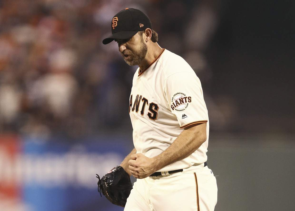 San Francisco Giants pitcher Madison Bumgarner reacts after striking out Chicago Cubs' Jorge Soler during the first inning of Game 3 of baseball's National League Division Series in San Francisco, Monday, Oct. 10, 2016. (Ezra Shaw, Getty Images via AP, Pool)