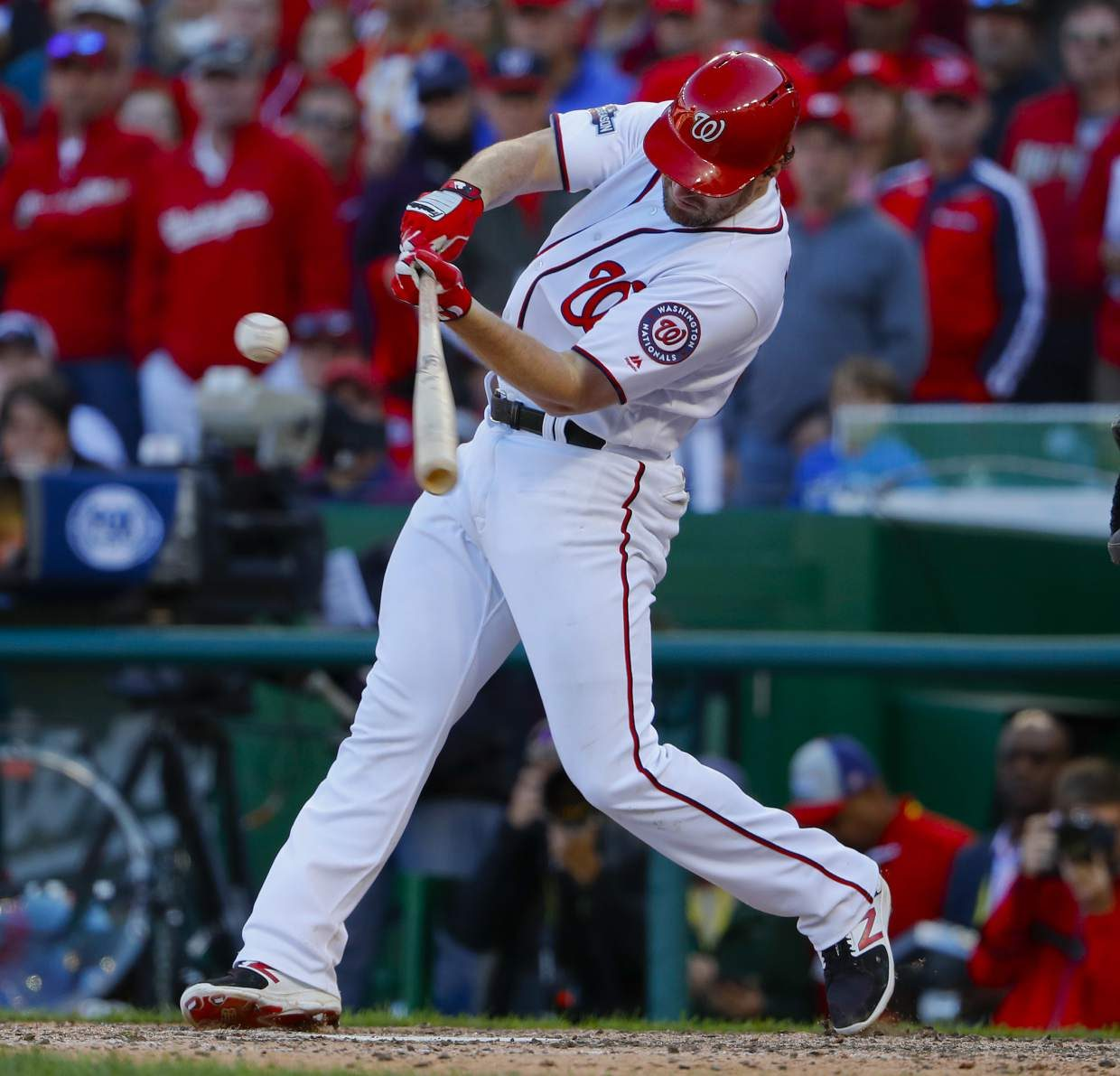 Washington Nationals' Daniel Murphy hits an RBI-single against the Los Angeles Dodgers during the seventh inning in Game 2 of baseball's National League Division Series at Nationals Park, Sunday, Oct. 9, 2016, in Washington. (AP Photo/Pablo Martinez Monsivais)