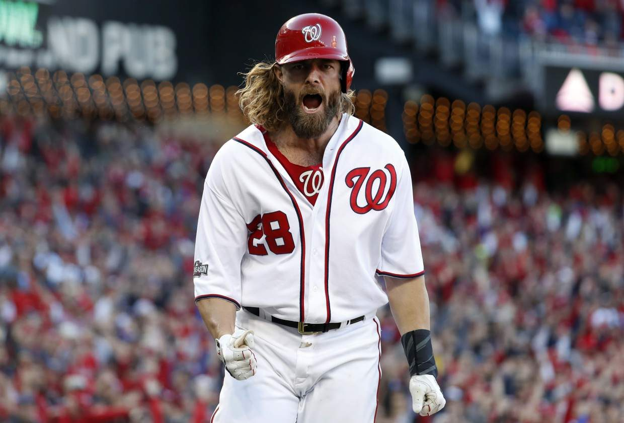 Washington Nationals' Jayson Werth celebrates after scoring on a single by Daniel Murphy during the seventh inning of Game 2 of baseball's National League Division Series against the Los Angeles Dodgers at Nationals Park, Sunday, Oct. 9, 2016, in Washington. (AP Photo/Alex Brandon)