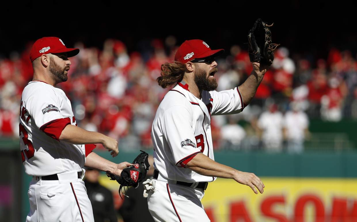 Washington Nationals relief pitcher Marc Rzepczynski, left, and Washington Nationals left fielder Jayson Werth (28) celebrate during Game 2 of baseball's National League Division Series against the Los Angeles Dodgers, at Nationals Park, Sunday, Oct. 9, 2016, in Washington. (AP Photo/Alex Brandon)