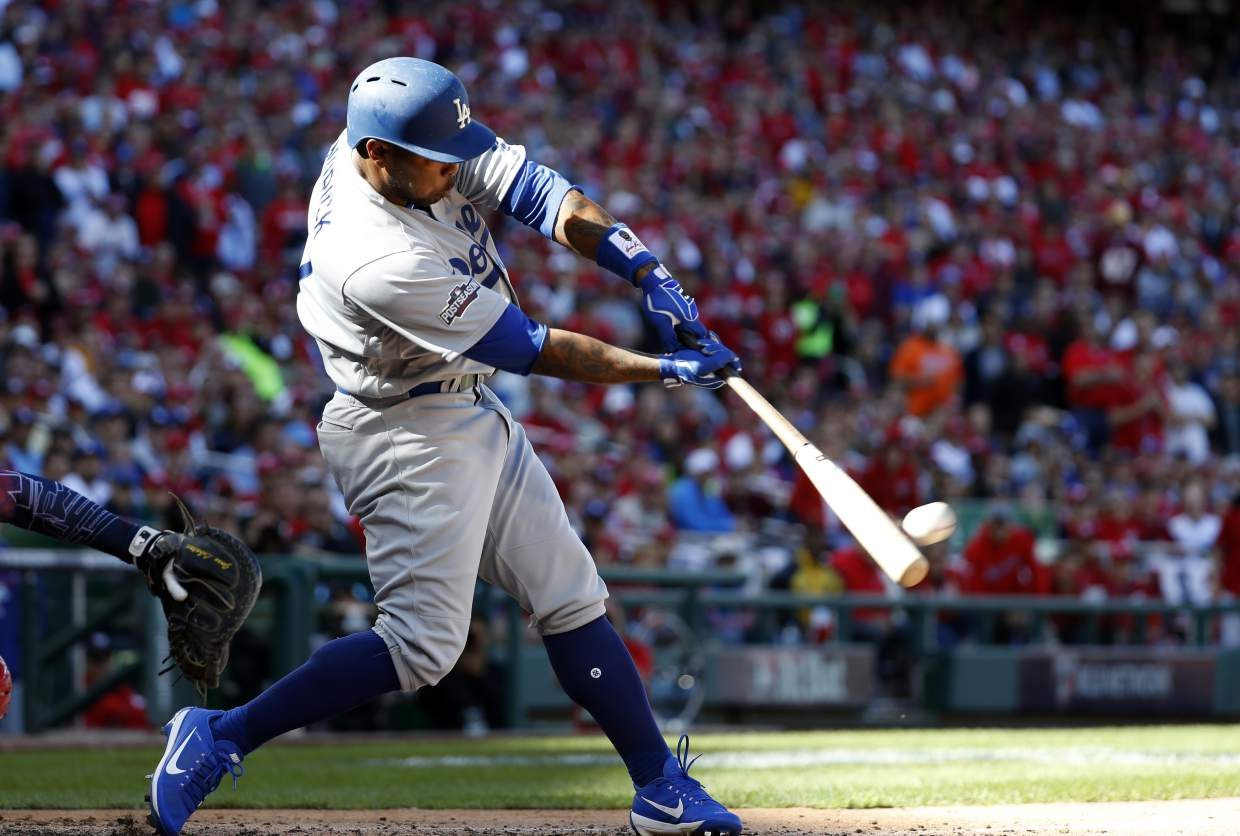 Los Angeles Dodgers left fielder Howie Kendrick (47) bats during Game 2 of baseball's National League Division Series against the Washington Nationals, at Nationals Park, Sunday, Oct. 9, 2016, in Washington. (AP Photo/Alex Brandon)