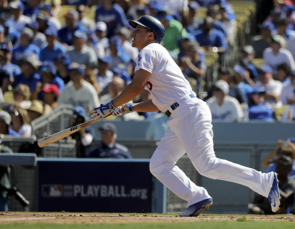 Los Angeles Dodgers' Corey Seager watches his RBI-double during the first inning in Game 3 of baseball's National League Division Series against the Washington Nationals in Los Angeles, Monday, Oct. 10, 2016. (AP Photo/Jae C. Hong)