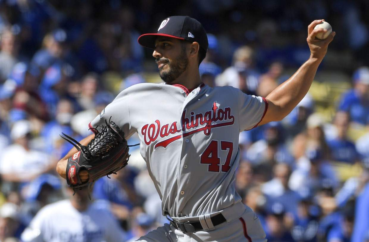 Washington Nationals starting pitcher Gio Gonzalez throws against the Los Angeles Dodgers during the first inning in Game 3 of baseball's National League Division Series in Los Angeles, Monday, Oct. 10, 2016. (AP Photo/Mark J. Terrill)