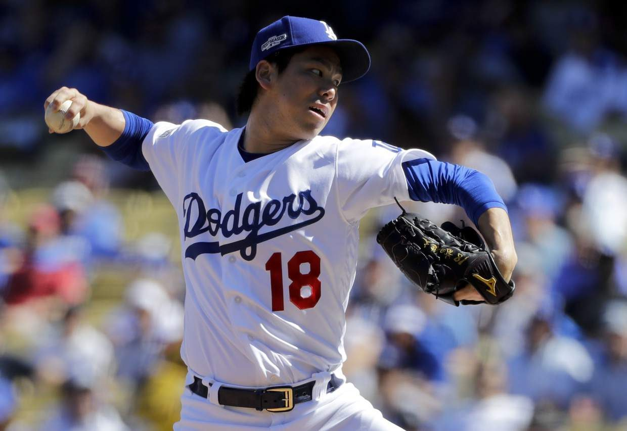Los Angeles Dodgers starting pitcher Kenta Maeda, of Japan, throws against the Washington Nationals during the first inning in Game 3 of baseball's National League Division Series in Los Angeles, Monday, Oct. 10, 2016. (AP Photo/Jae C. Hong)
