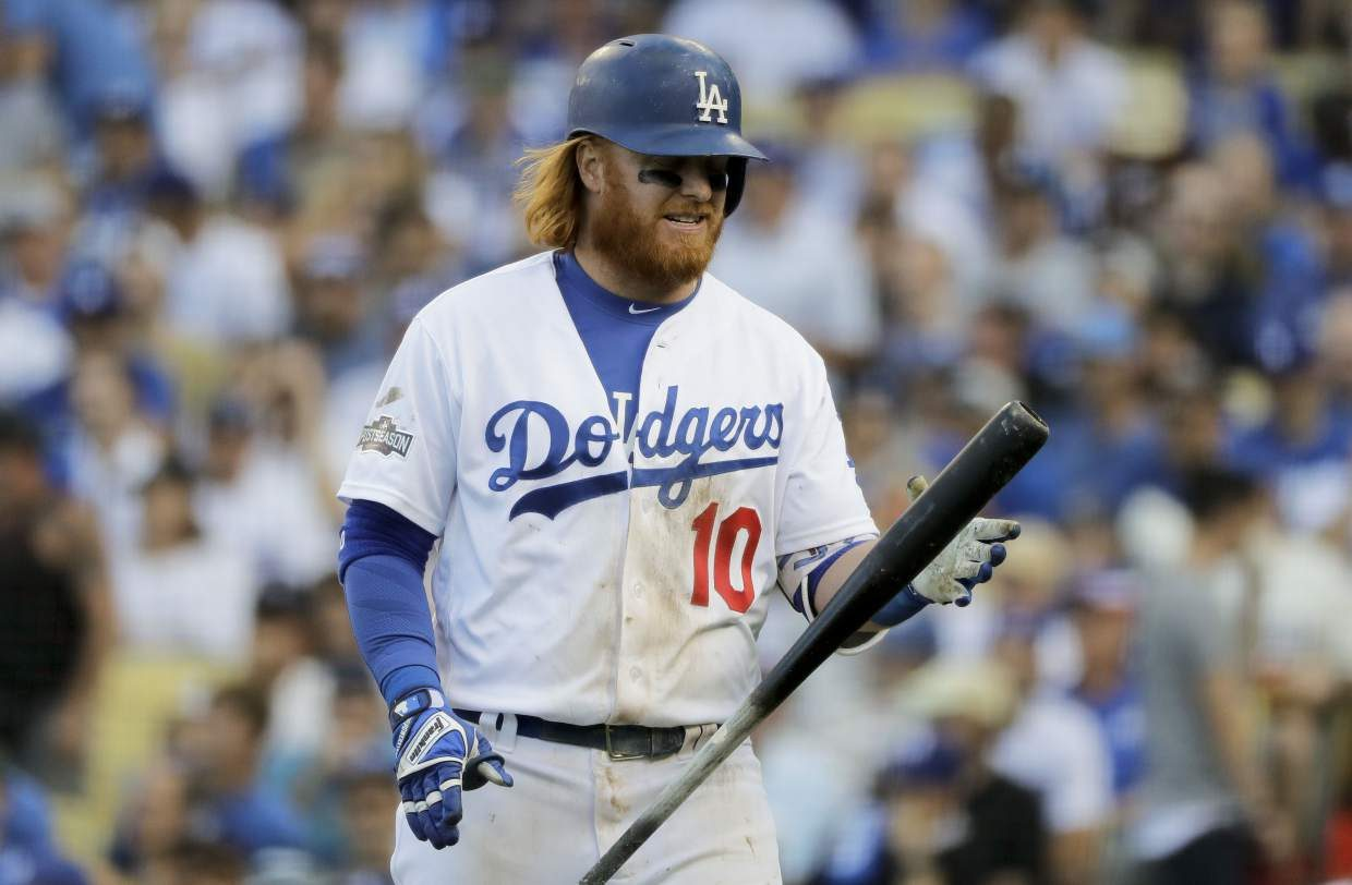 Los Angeles Dodgers' Justin Turner reacts after striking out against the Washington Nationals during the seventh inning in Game 3 of baseball's National League Division Series in Los Angeles, Monday, Oct. 10, 2016. (AP Photo/Jae C. Hong)