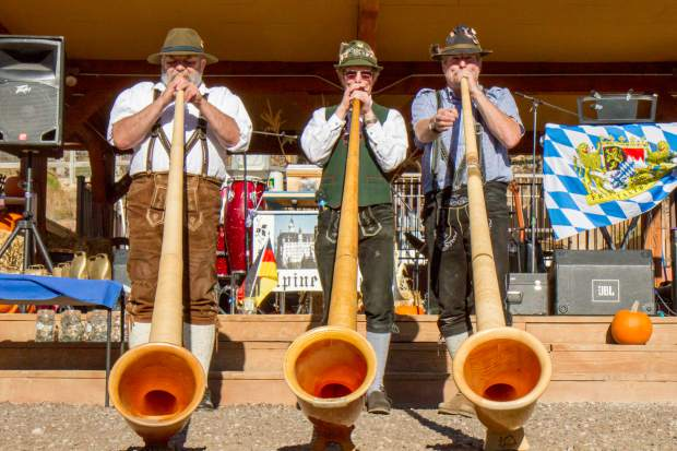 Members of the band Alpine Echo play for the crowd at the Glenwood Caverns Adventure Park Mountain Fall Oktoberfest on Saturday afternoon.