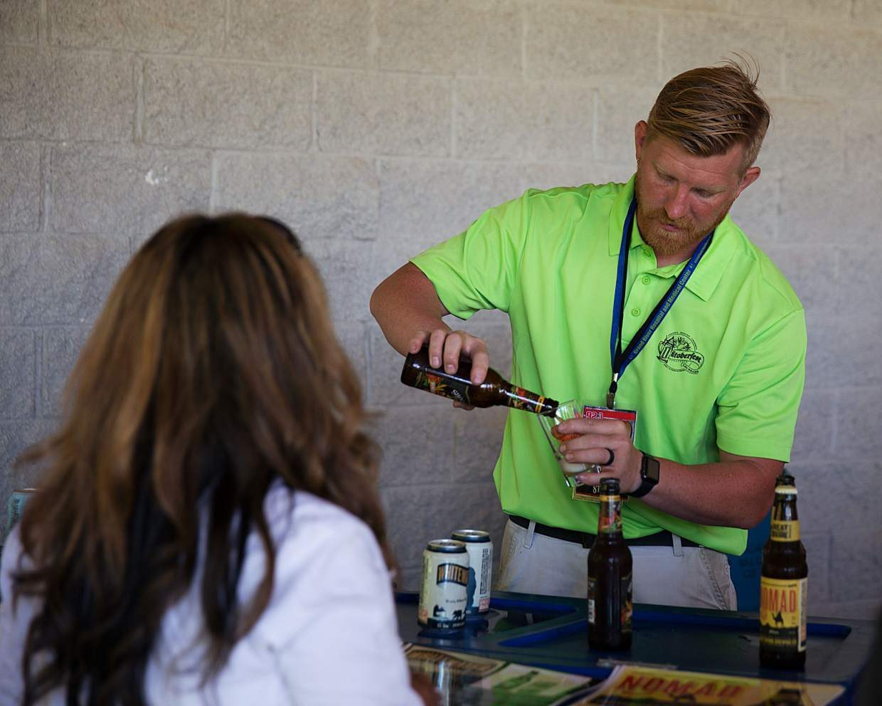 Derek Wingfield, Parachute community development director, pours a beer at the 2016 Oktoberfest.