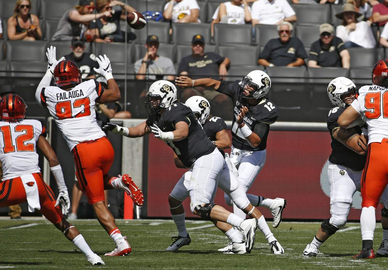 Colorado quarterback Steven Montez (12) throws a pass against Oregon State during the first half of an NCAA college football game in Boulder, Colo., Saturday, Oct. 1, 2016. (AP Photo/Brennan Linsley)