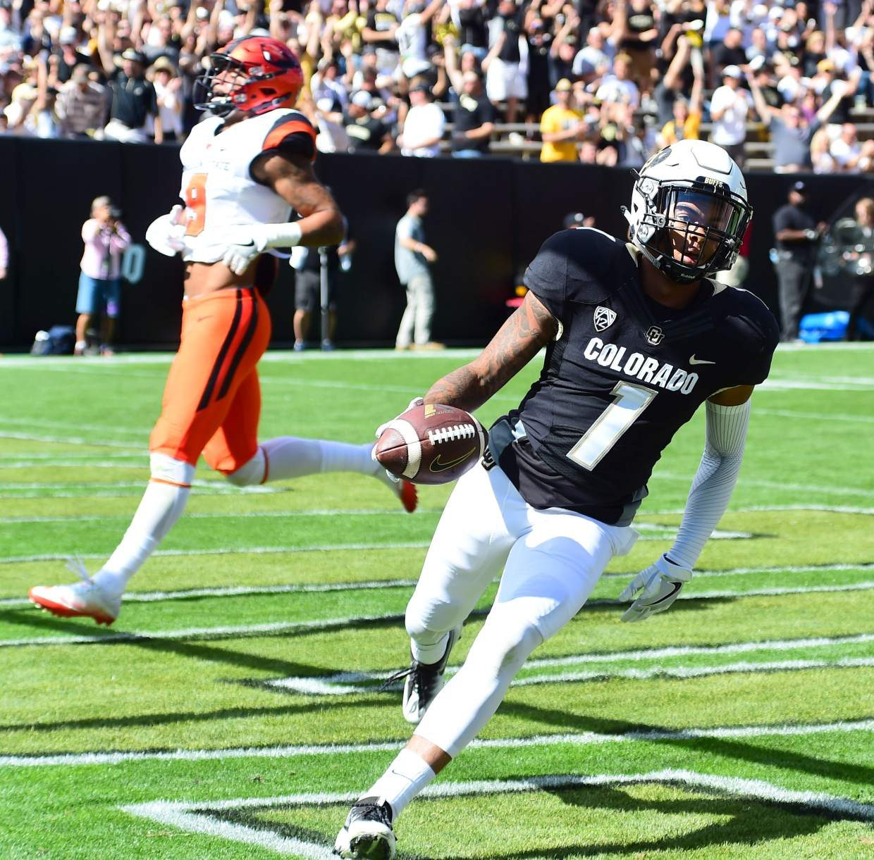 Colorado's Shay Fields scores a touchdown past Oregon State's Devin Chappell during an NCAA college football game Saturday, Oct. 1, 2016, in Boulder, Colo. (Cliff Grassmick/Daily Camera via AP)