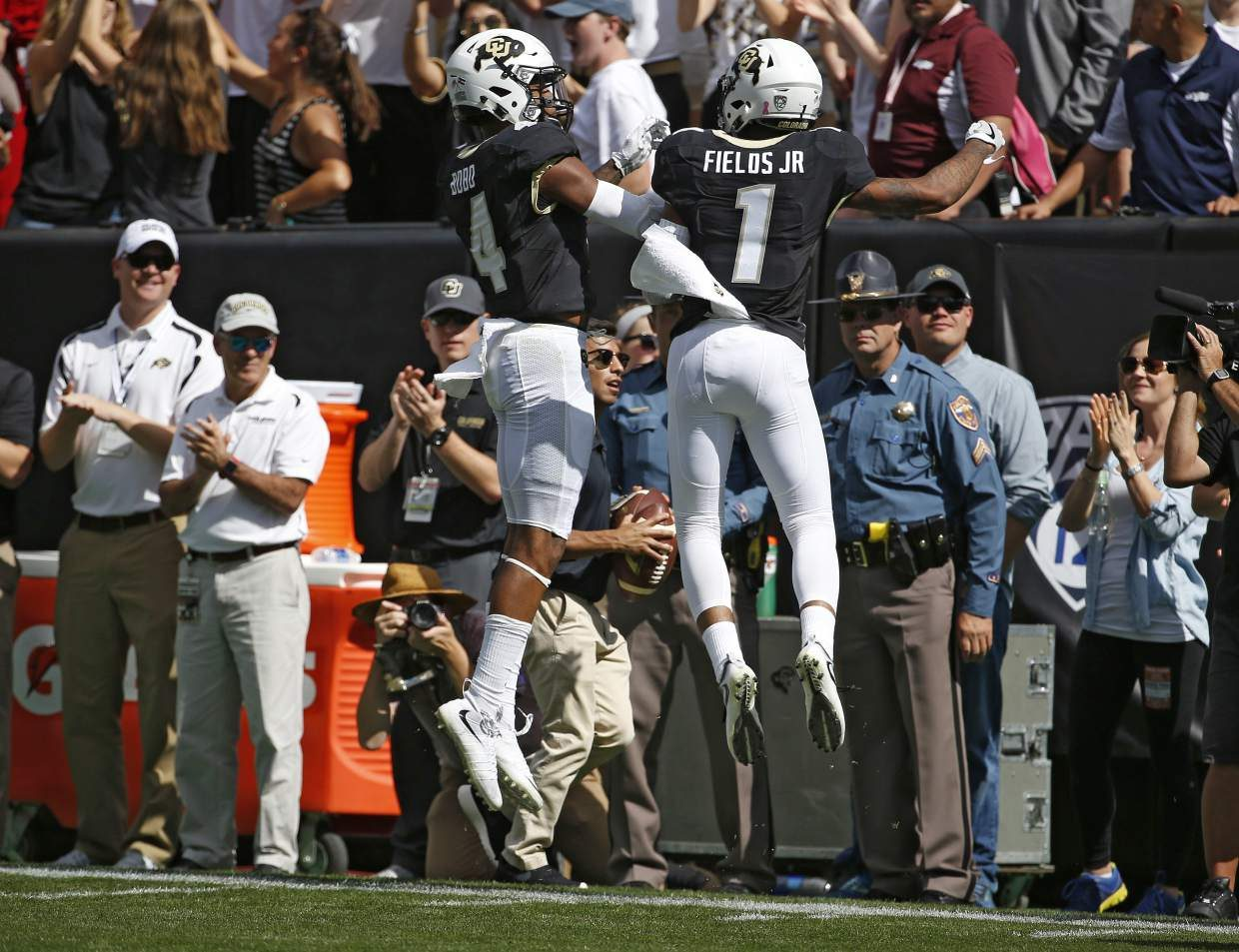 Colorado wide receiver Shay Fields (1) celebrates with fellow wide receiver Bryce Bobo, (4) after Fields ran in a catch for a touchdown against Oregon State during the first half of an NCAA college football game in Boulder, Colo., Saturday, Oct. 1, 2016. (AP Photo/Brennan Linsley)
