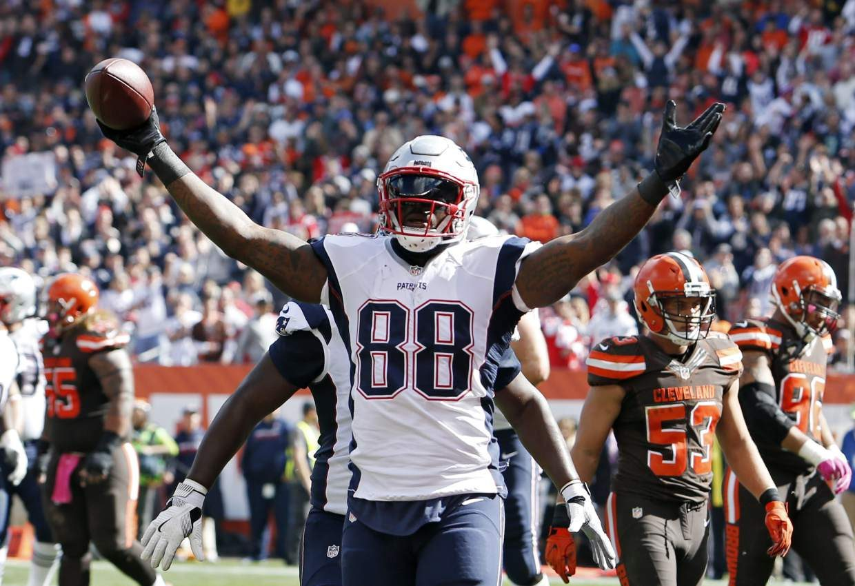 New England Patriots tight end Martellus Bennett celebrates a touchdown catch against the Cleveland Browns in the first half of an NFL football game Sunday, Oct. 9, 2016, in Cleveland. (AP Photo/Ron Schwane)