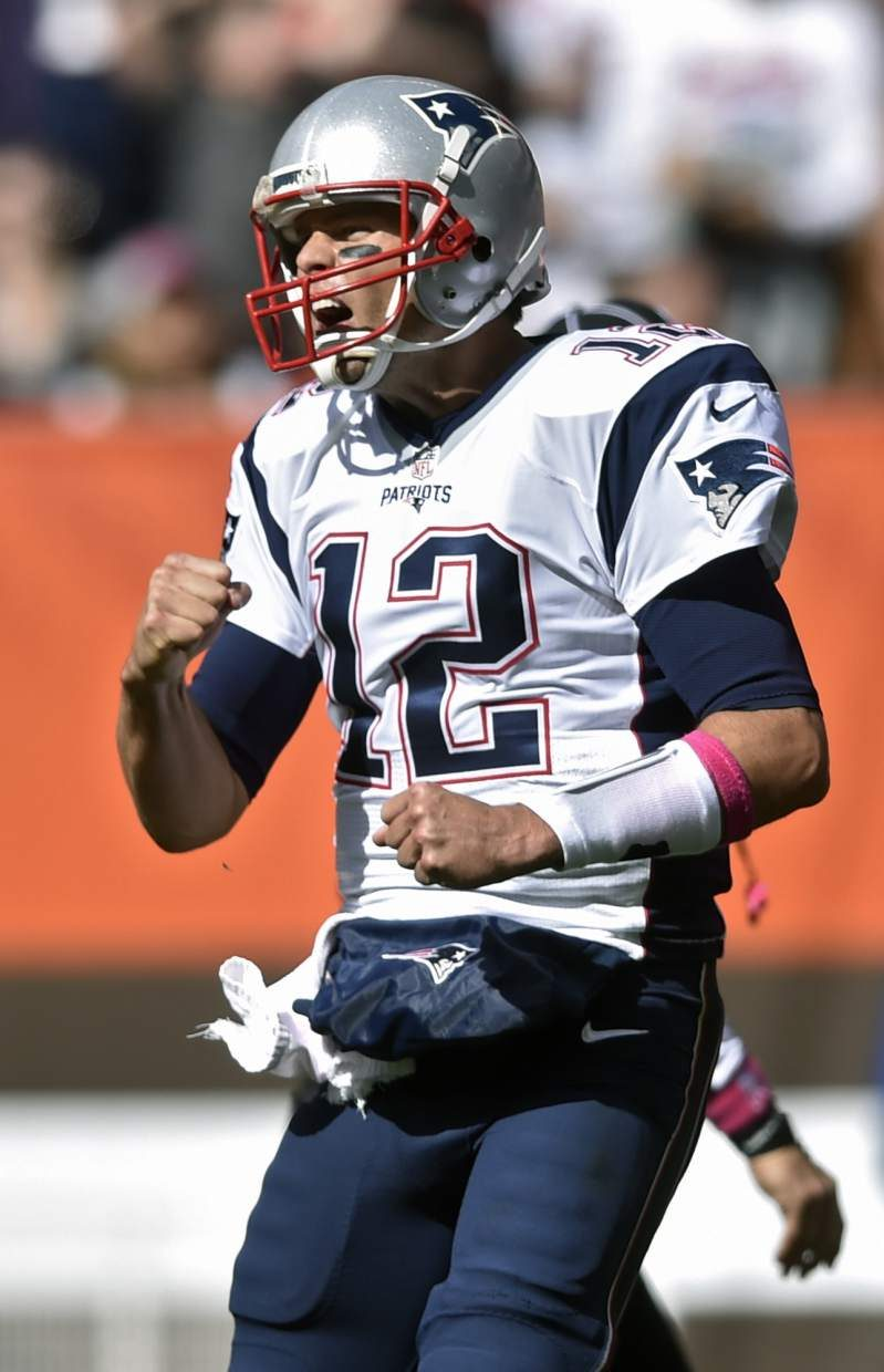 New England Patriots quarterback Tom Brady celebrates a touchdown in the first half of an NFL football game against the Cleveland Browns, Sunday, Oct. 9, 2016, in Cleveland. (AP Photo/David Richard)