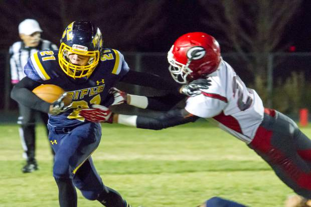 The Rifle Bears narrowly escaped with a victory against the Glenwood Springs Demons in a nail-biting game that went down to the final seconds on Friday night at Rifle High School.