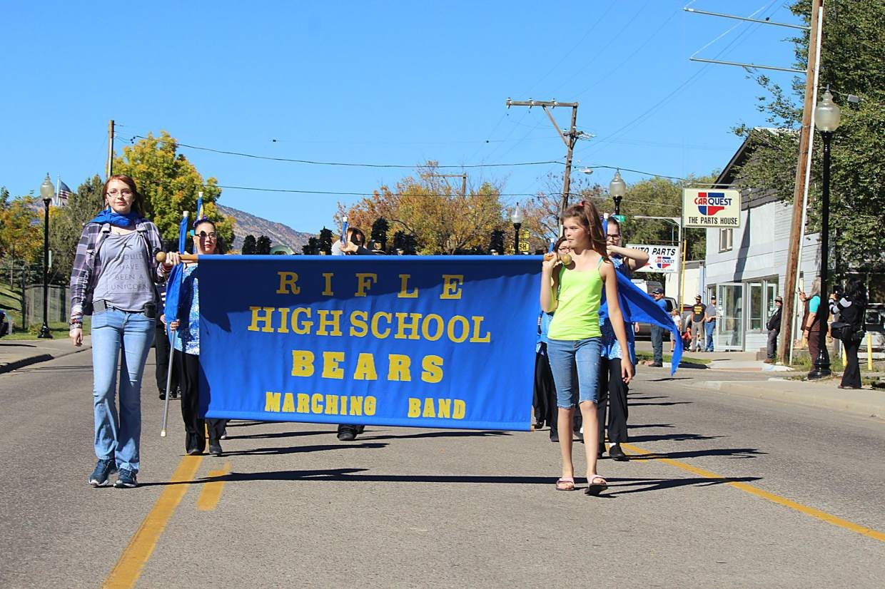 The Rifle High School marching band marches down Railroad Avenue in the 2016 homecoming parade.