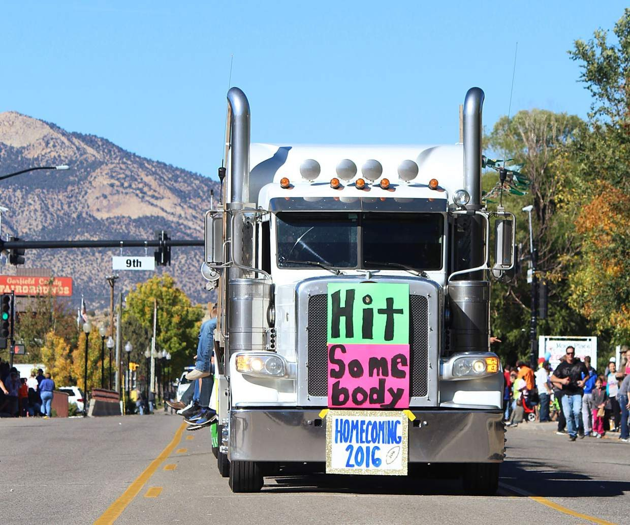 The Rifle High School football team homecoming float makes its way down Railroad Avenue Friday.