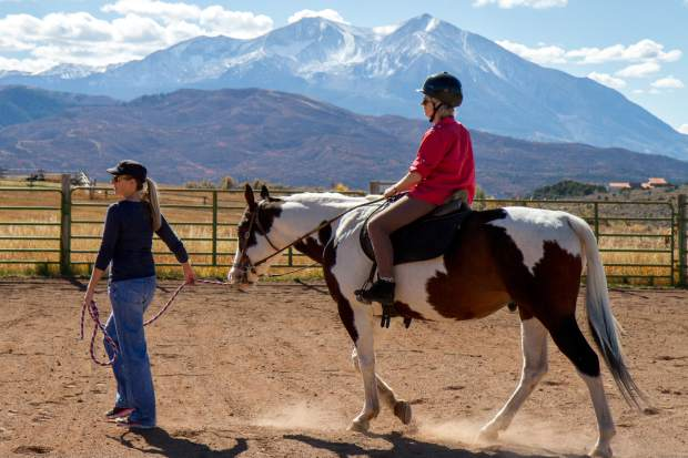 Anne Merz who was diagnosed with multiple sclerosis takes part in equine therapy at WindWalkers to help strengthen the muscles in her back and legs.