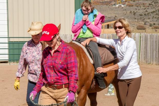 Amanda VanDeursen riding horse Freddy during her session with the WindWalkers Equine Assisted Learning and Therapy Center.
