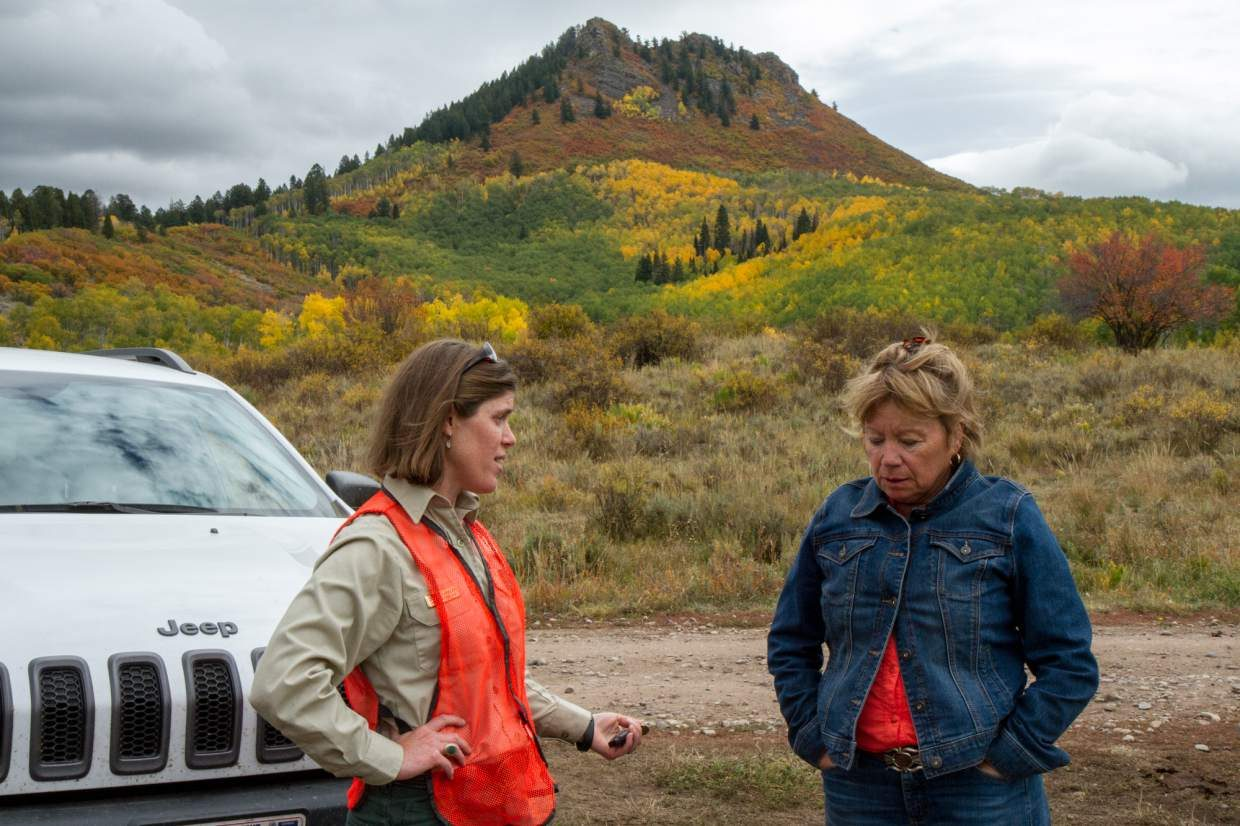 Rifle District Ranger Sarah Hankens speaks with a range permittee who runs cattle near Haystack Mountain south of RIfle.