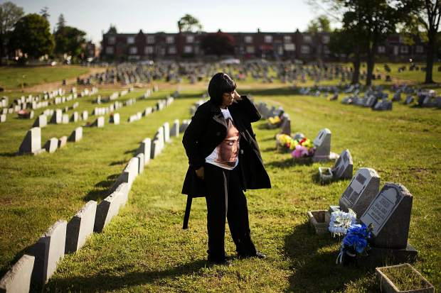 Dorothy Johnson-Speight visits the grave of her son, Khaaliq Jabbar Johnson, in Philadelphia. Johnson was killed in 2001 — shot seven times over a parking space dispute.