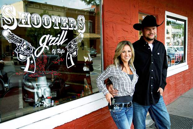 Lauren and Jayson Boebert, owners of the Shooters Grill in Rifle, stand outside their restaurant.