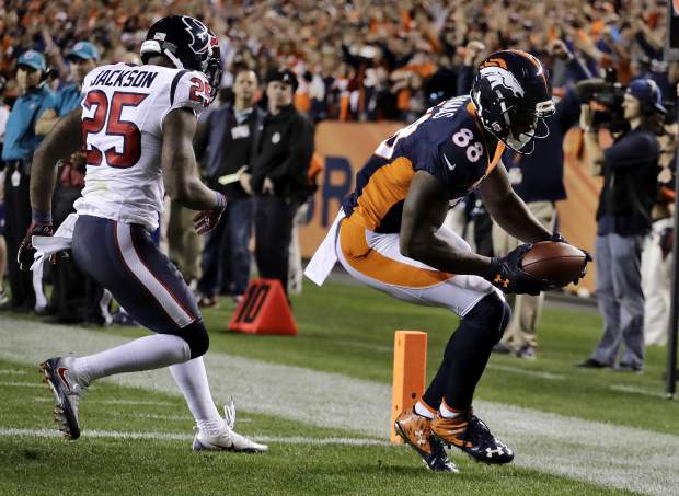 Denver Broncos wide receiver Demaryius Thomas (88) scores a touchdown as Houston Texans cornerback Kareem Jackson (25) defends during the first half of an NFL football game, Monday, Oct. 24, 2016, in Denver. (AP Photo/Jack Dempsey)