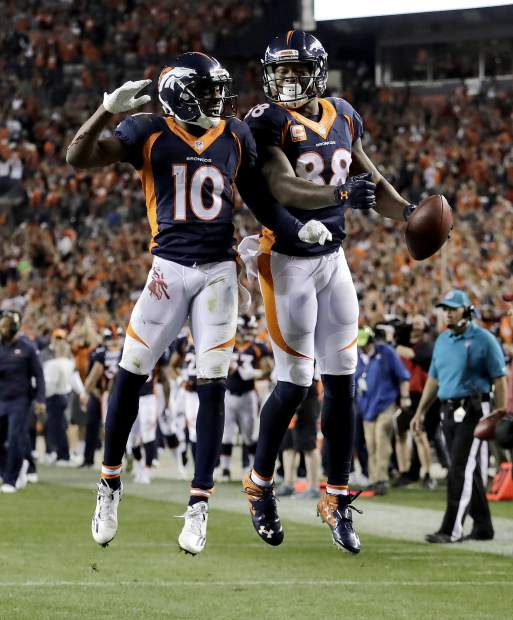 Denver Broncos wide receiver Demaryius Thomas (88) celebrates his touchdown with Emmanuel Sanders (10) during the first half of an NFL football game against the Houston Texans, Monday, Oct. 24, 2016, in Denver. (AP Photo/Jack Dempsey)