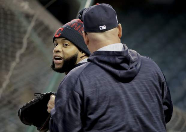 Cleveland Indians designated hitter Carlos Santana, left, talks with manager Terry Francona during warm ups during a team practice for baseball's upcoming World Series against the Chicago Cubs on Monday, Oct. 24, 2016 in Cleveland. (AP Photo/Charlie Riedel)
