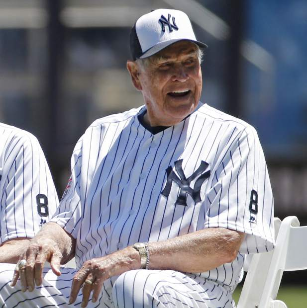 FILE - In this June 12, 2016, file photo, former New York Yankees player Eddie Robinson smiles before the Yankees annual Old Timers Day baseball game, in New York. The Cleveland Indians and the Chicago Cubs start the World Series with Game 1 in Cleveland on Tuesday, Oct. 25. Eddie Robinson is the last living member of the Cleveland Indians 1948 World Series team. (AP Photo/Kathy Willens, File)