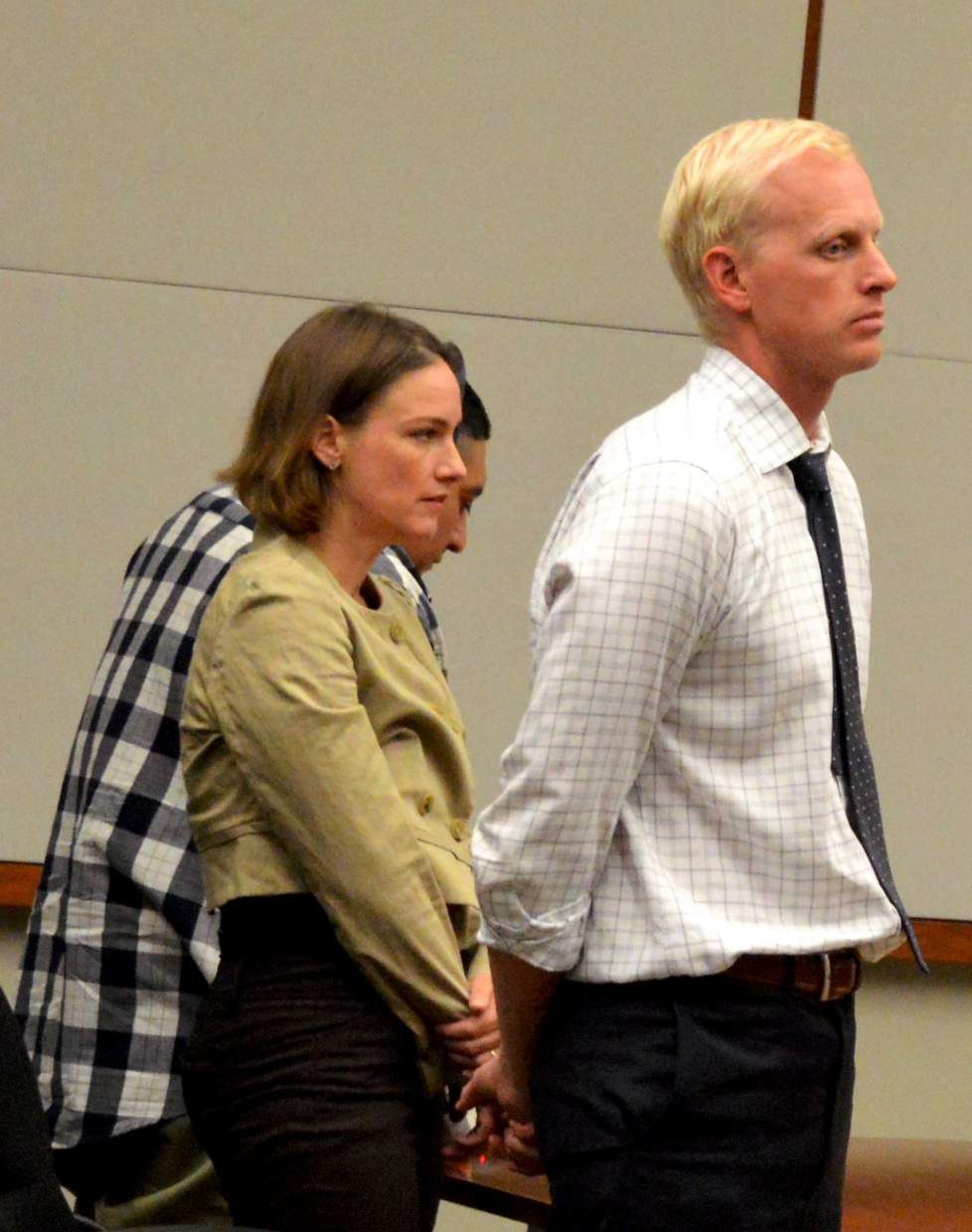Defense attorneys Thea Reiff and Reed Owens stand with their client Williams Amaya as the jury returns with its verdict.
