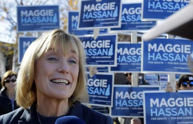 New Hampshire Democratic Senate candidate, Gov. Maggie Hassan speaks to reporters, Tuesday, Nov. 8, 2016, outside a polling place in Portsmouth, N.H. (AP Photo/Elise Amendola)