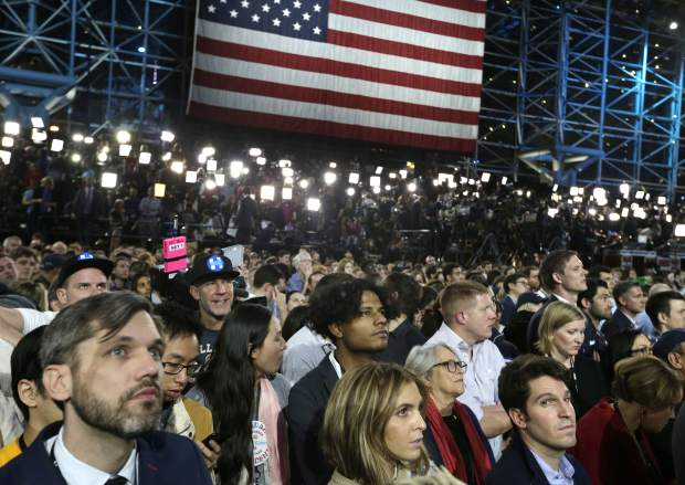 Supporters watch election results during Democratic presidential nominee Hillary Clinton's election night rally in the Jacob Javits Center glass enclosed lobby in New York, Tuesday, Nov. 8, 2016. (AP Photo/Frank Franklin II)