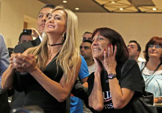 Supporters for Republican presidential candidate Donald Trump watch late returns against Democratic candidate Hillary Clinton Tuesday, Nov. 8, 2016, in Phoenix. (AP Photo/Ross D. Franklin)