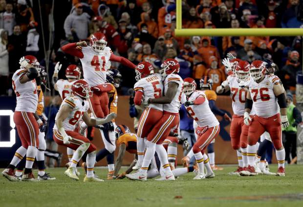 Kansas City Chiefs kicker Cairo Santos (5) celebrates his game winning field goal with teammates during overtime of an NFL football game against the Denver Broncos, Sunday, Nov. 27, 2016, in Denver. The Chiefs won 30-27 in overtime. (AP Photo/Jack Dempsey)