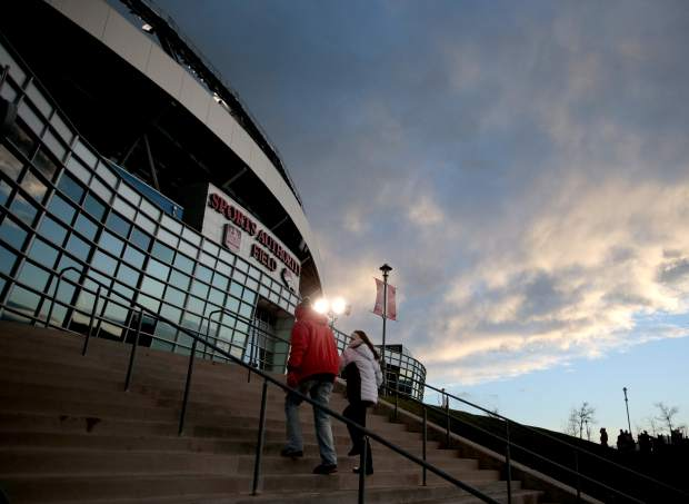 Denver Broncos fans arrive at Mile High Stadium prior to an NFL football game against the Kansas City Chiefs, Sunday, Nov. 27, 2016, in Denver. (AP Photo/Joe Mahoney)