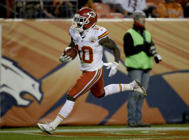 Kansas City Chiefs wide receiver Tyreek Hill (10) runs back a punt for a touchdown against the Denver Broncos during the first half of an NFL football game, Sunday, Nov. 27, 2016, in Denver. (AP Photo/Joe Mahoney)